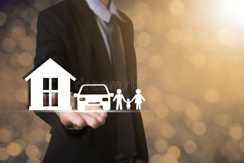 Hand holding home car family. concept assurance health-care. Insurance stock photos