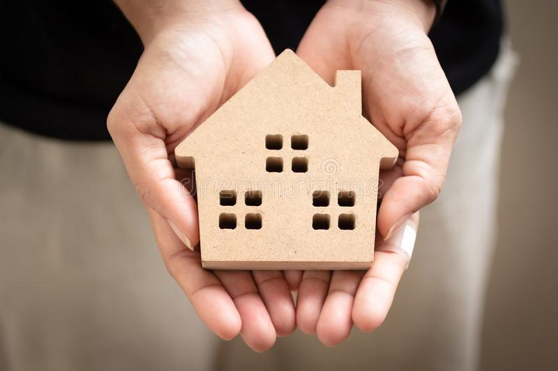 Hand holding home model, happy homes for families.  royalty free stock images