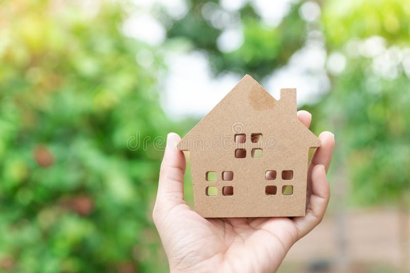 Hand holding home model, happy homes for families.  stock photography