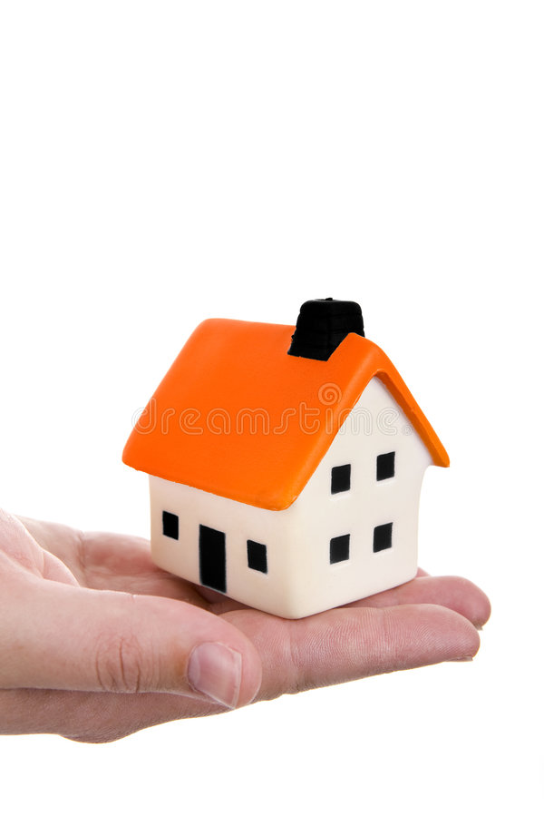Hand holding a house. Human hand holding a small house royalty free stock image