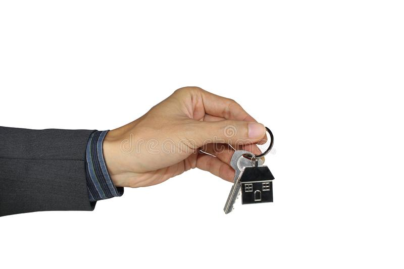 Hand holding the house key isolated on a white background, With clipping path stock images