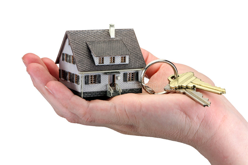 Hand holding house keys stock photography