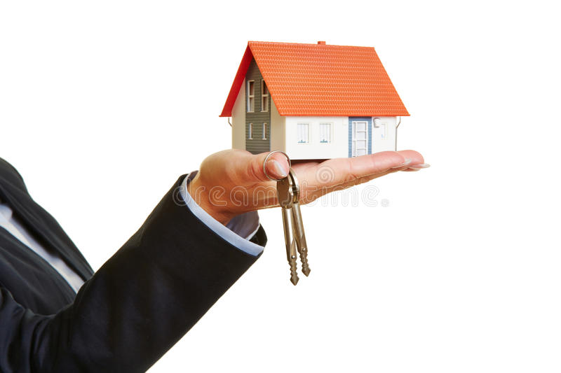 Hand holding house and keys stock photography