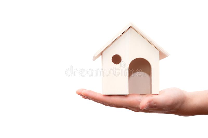 Hand holding house wooden isolated on white background. royalty free stock photos