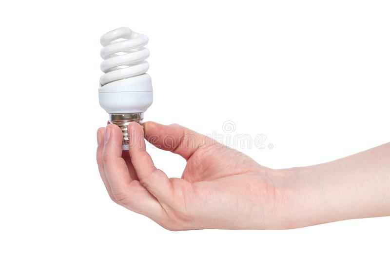 Hand holding Illuminated light bulb isolated on white background. Energy-saving lamp in hand on white background stock photography
