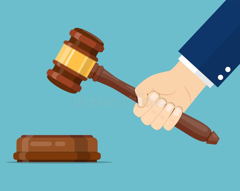 Hand holding judges gavel stock illustration
