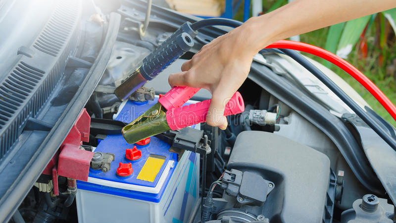 Hand holding jumper cable. For recharge the battery car stock photos