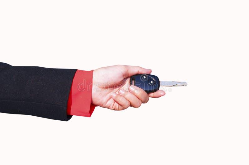 hand holding key of car isolated on white background. royalty free stock photos
