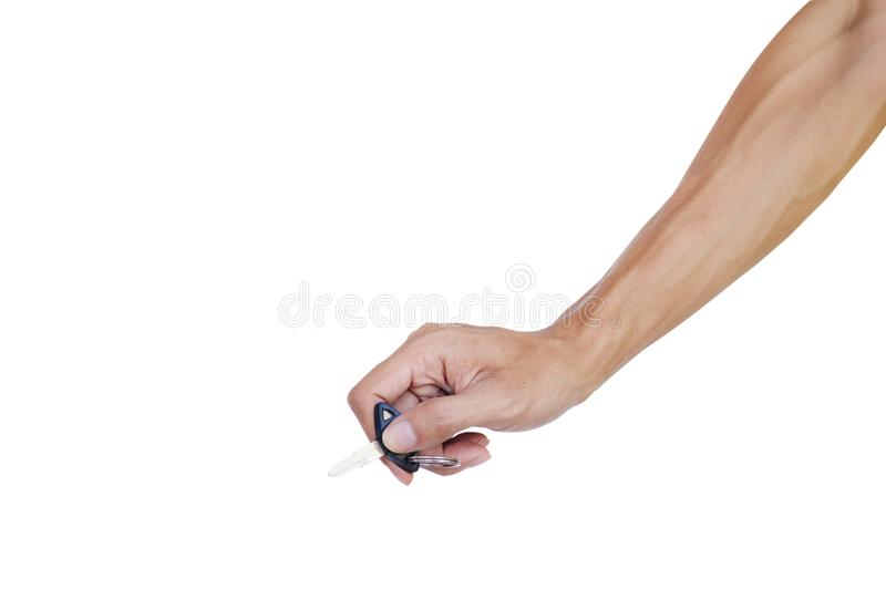 Hand holding a key isolated on white background with clipping path. A tool for locking Or open-close engine. Key for car royalty free stock photo