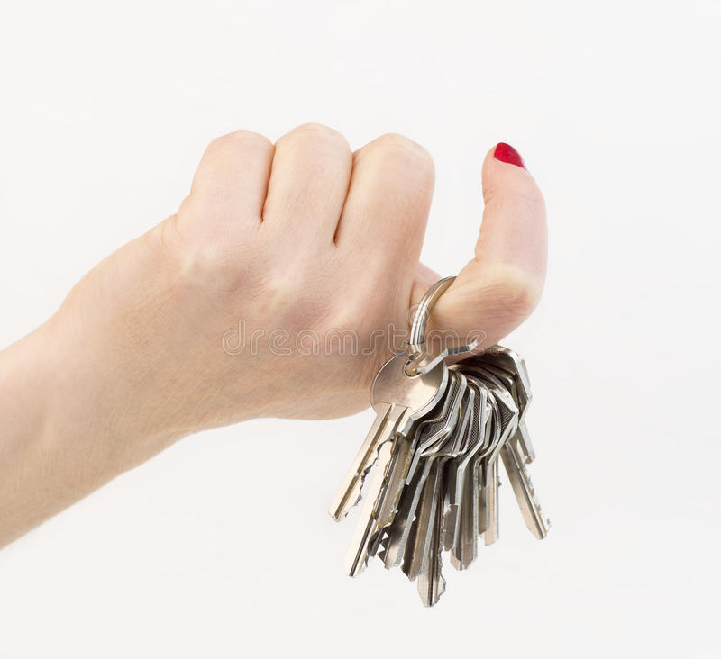 Hand holding a keys royalty free stock image