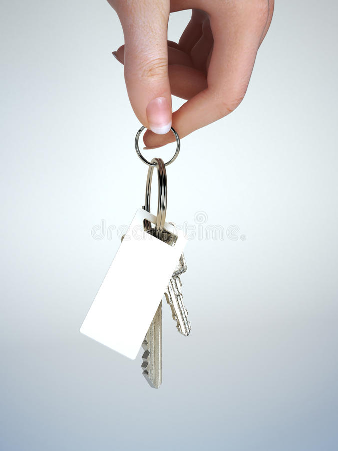 Hand holding keys with key chain. Having room for text ,graphic or copy space. Vehicle ownership , insurance,service ect. Gradient background royalty free stock photography