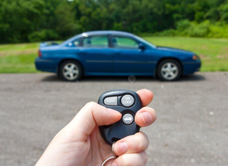 Hand holding keys to a car stock photos
