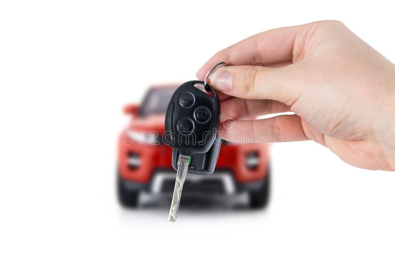 Hand holding keys to new car. Buy or selling business composition royalty free stock image