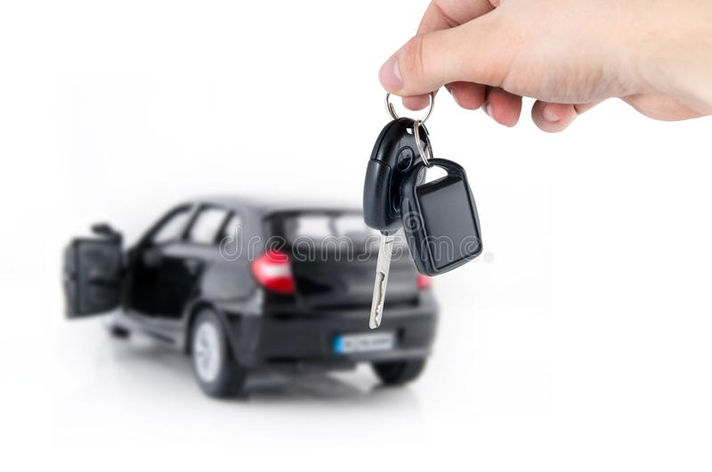 Hand holding keys to new car. stock photo