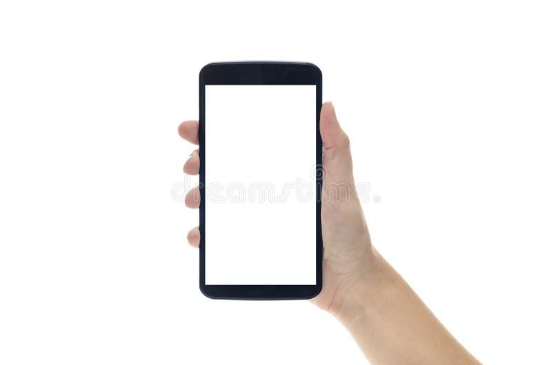 Hand Holding Large Smartphone on Blank White Background royalty free stock photography