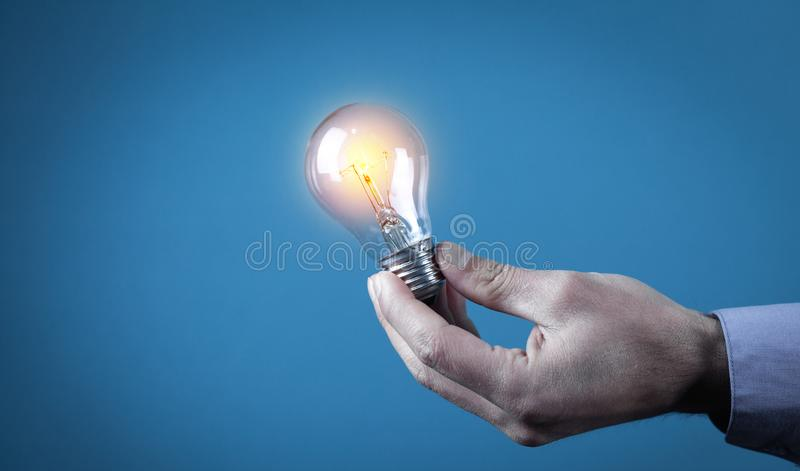 Hand holding light bulb. Concept of inspiration and creativity royalty free stock photos