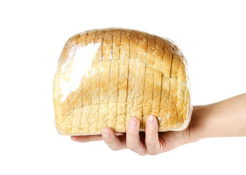 Hand holding a loaf of sliced bread. Close up. Isolated on white background royalty free stock photos