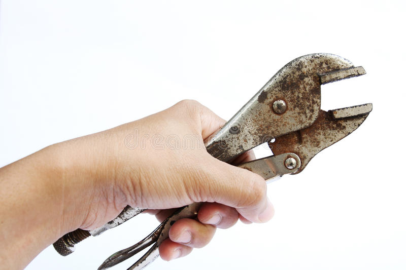 Hand holding locking grip pliers. The hand holding locking grip pliers royalty free stock image
