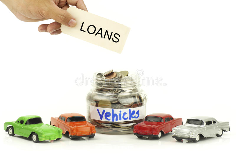 Hand holding lons sign over money. Coins and toy car isolated on white background stock photos