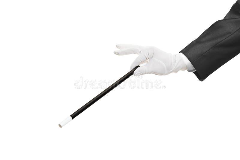 Hand holding a magic wand. Isolated on white background stock image
