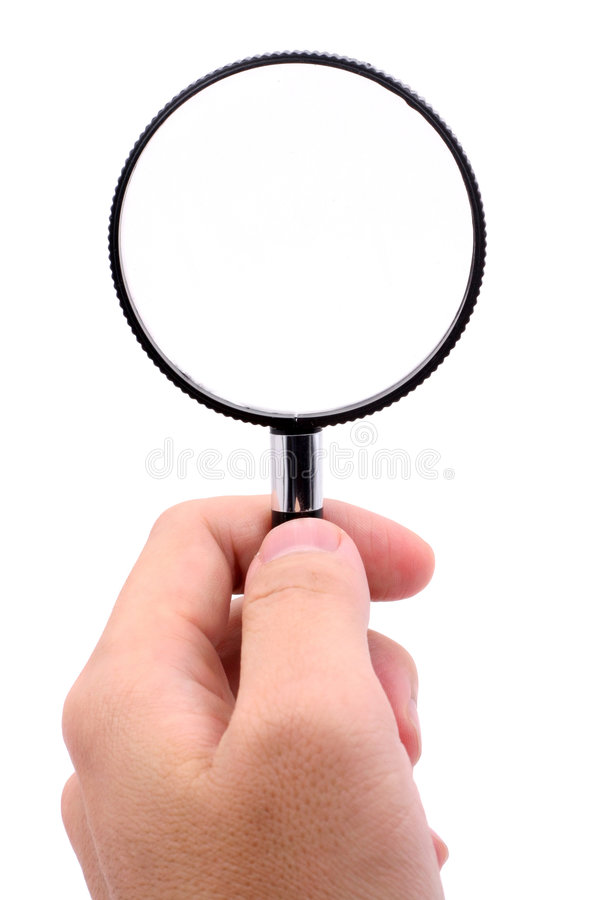 Hand holding magnifier royalty free stock images