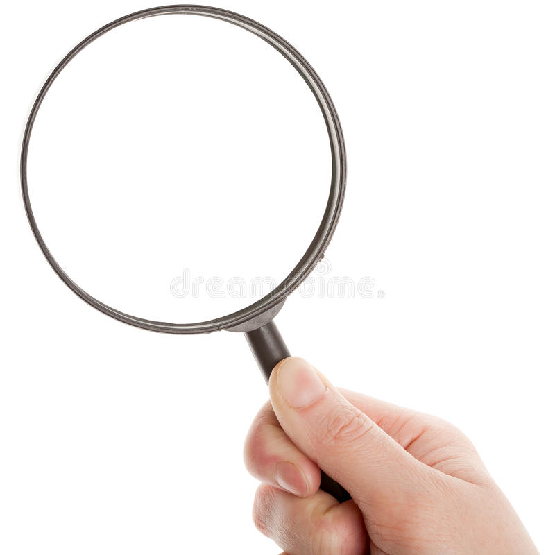 Hand holding magnifying glass royalty free stock photography