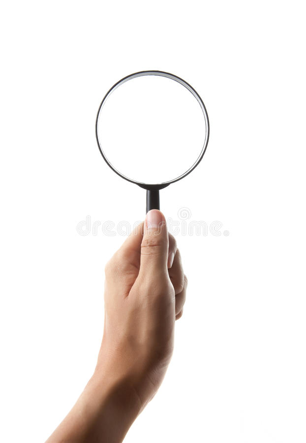 Hand holding magnifying glass isolated stock photo