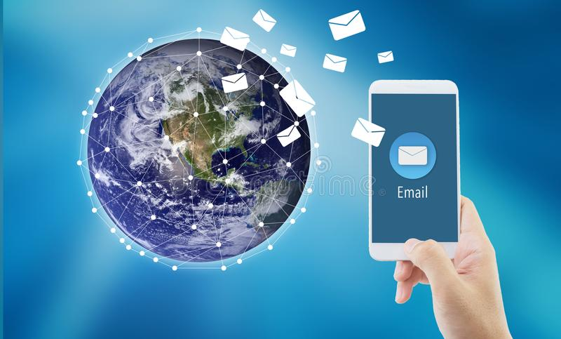 Hand holding man check and sending message with email in a phone on world background. Communication concept, Elements of this image furnished by NASA stock photography