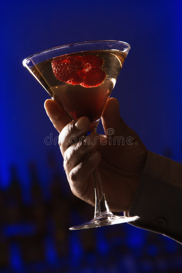 Download Hand holding martini. stock image. Image of backlit, holding - 2431435