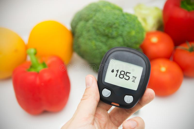 Hand holding meter. Diabetes doing glucose level test. stock photography