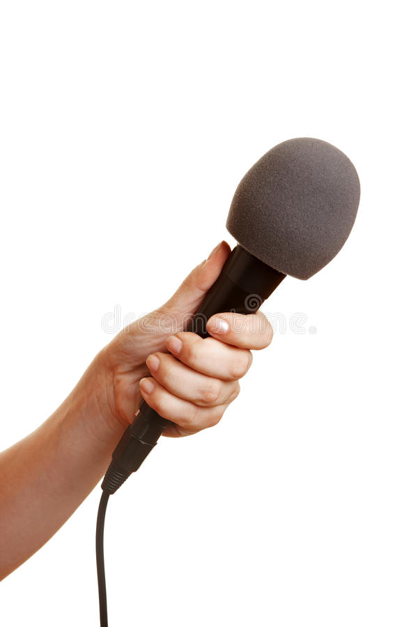 Hand holding microphone stock photos