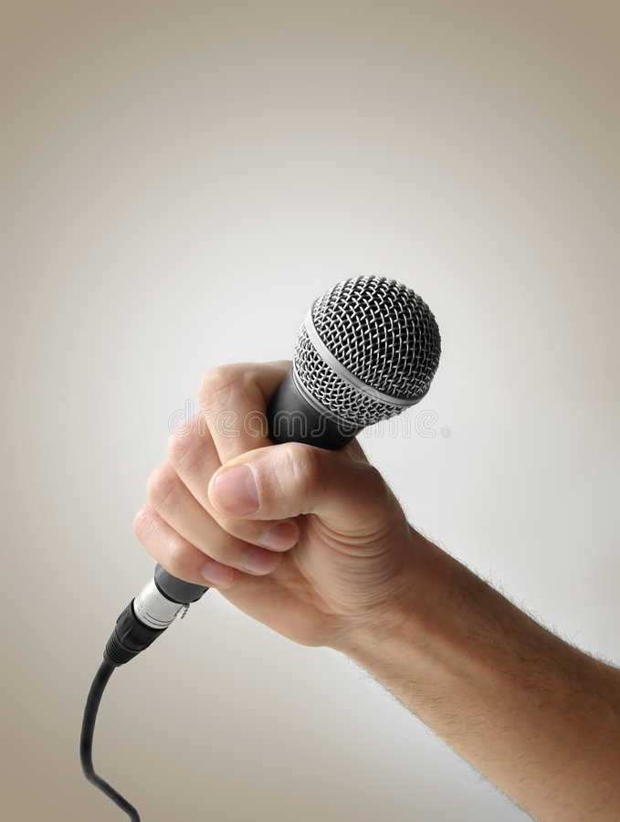 Hand holding microphone stock photo