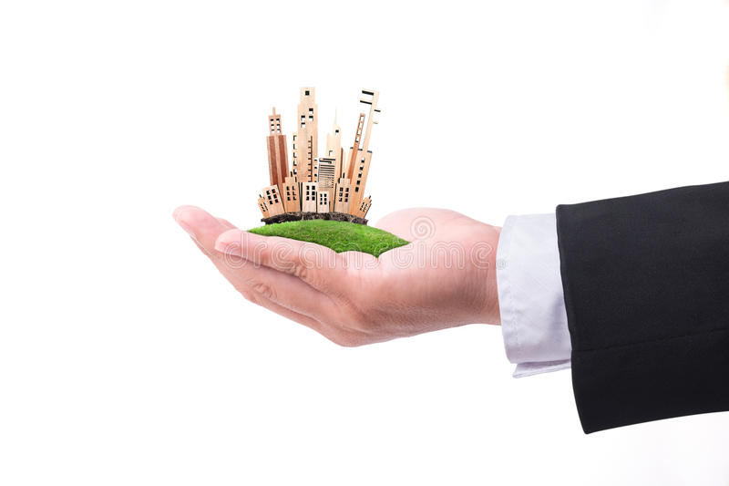 Hand holding miniature building model On white background. Real. Estate concept stock image