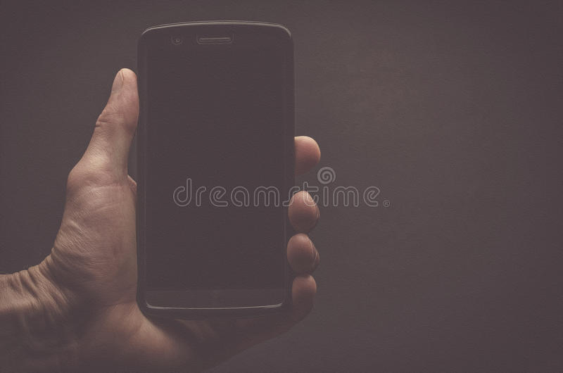 Hand holding a mobile phone royalty free stock photo
