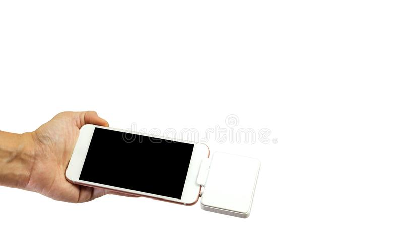Hand holding Mockup smart phone with Modern credit card machine stock photo