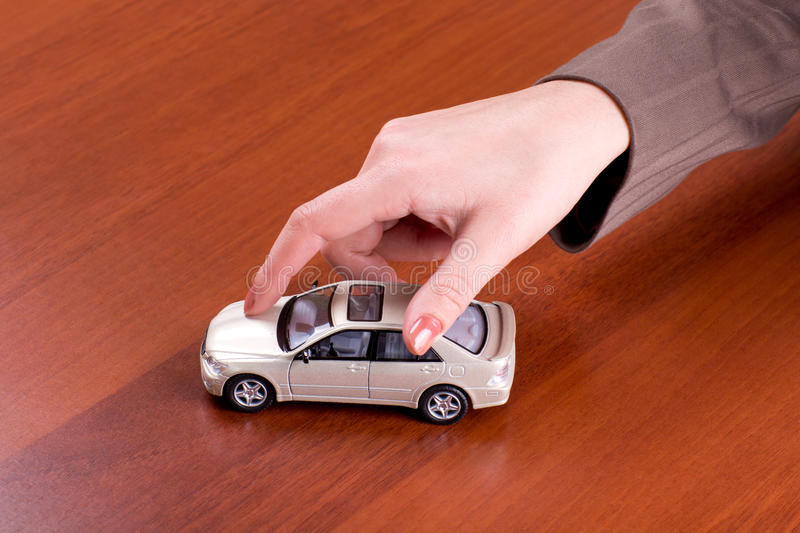 Hand holding the model of car royalty free stock photo