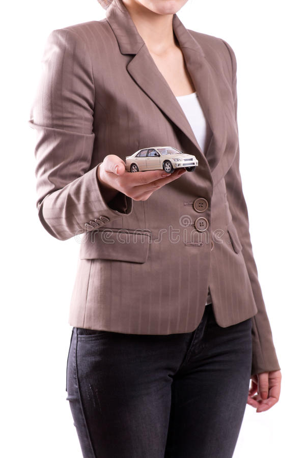 Hand holding the model of car royalty free stock image