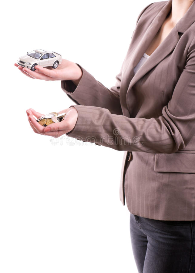 Hand holding the model of car and coins. Woman's hand holding the model of car and coins stock images