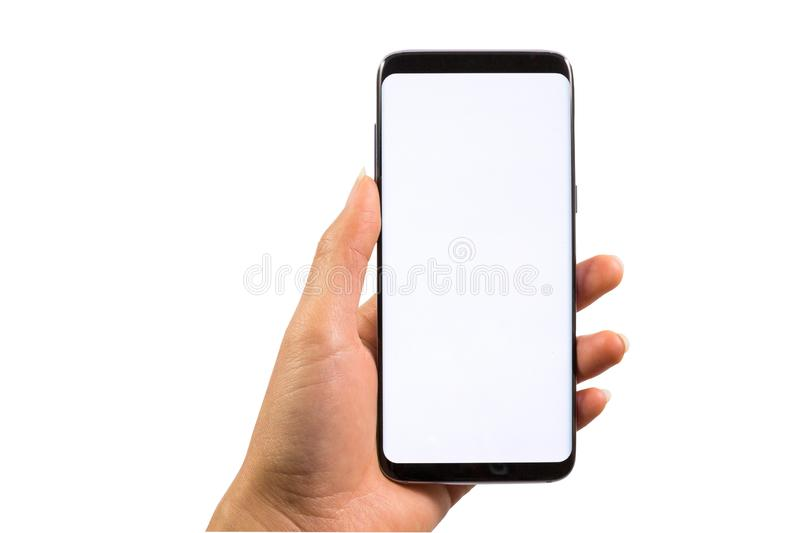 Hand holding the modern smartphone with blank screen and modern frameless design - isolated on white background with clipping path stock image
