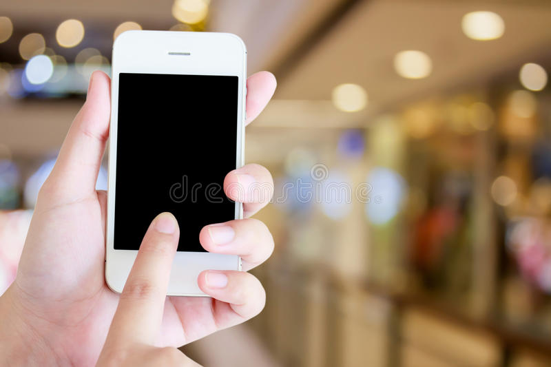 Hand holding a modern touch screen phone stock photo