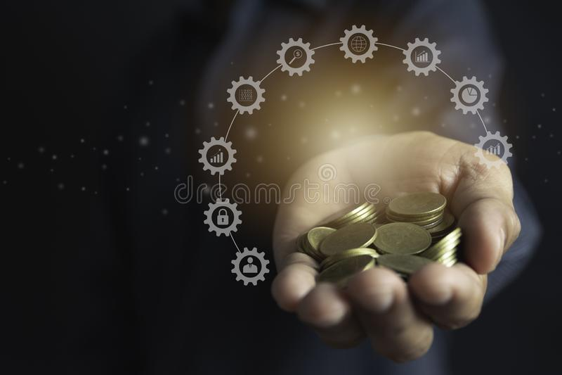 Hand holding money gold coins with plant in hand for financial and saving money concept royalty free stock photo