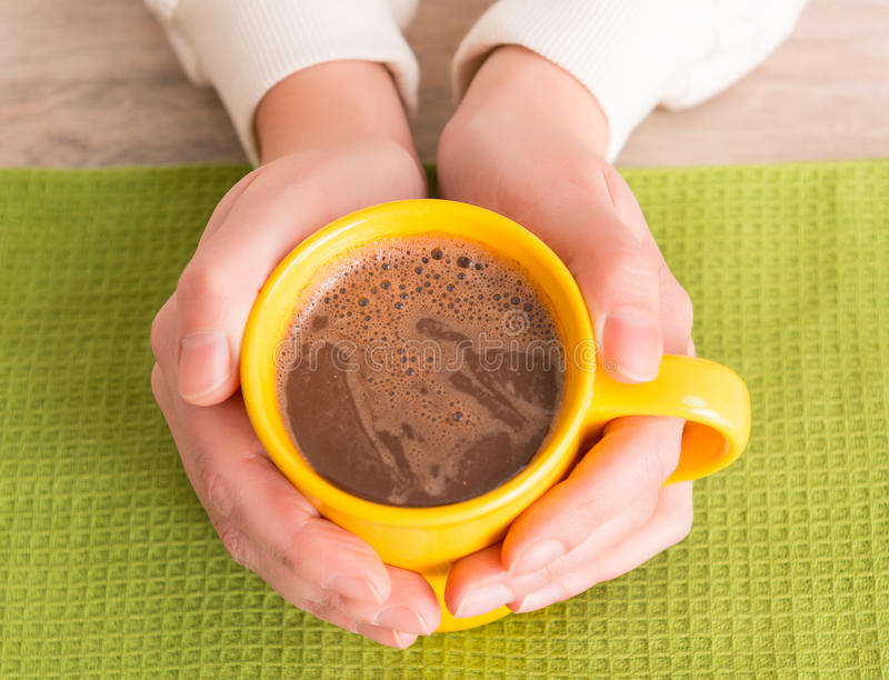 Hand holding a mug with coffee royalty free stock images