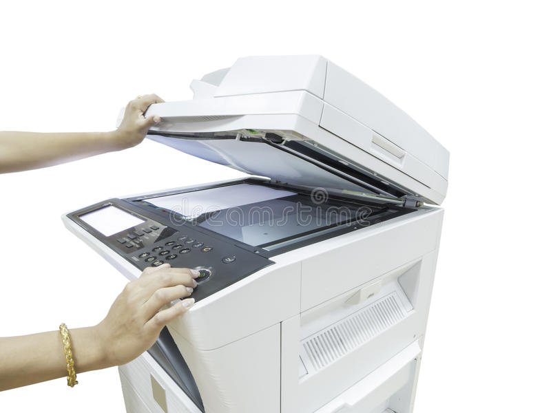 Hand holding a multi purpose copier machine isolated on whi. A person handling a multi purpose copier machine isolated on white background stock photography