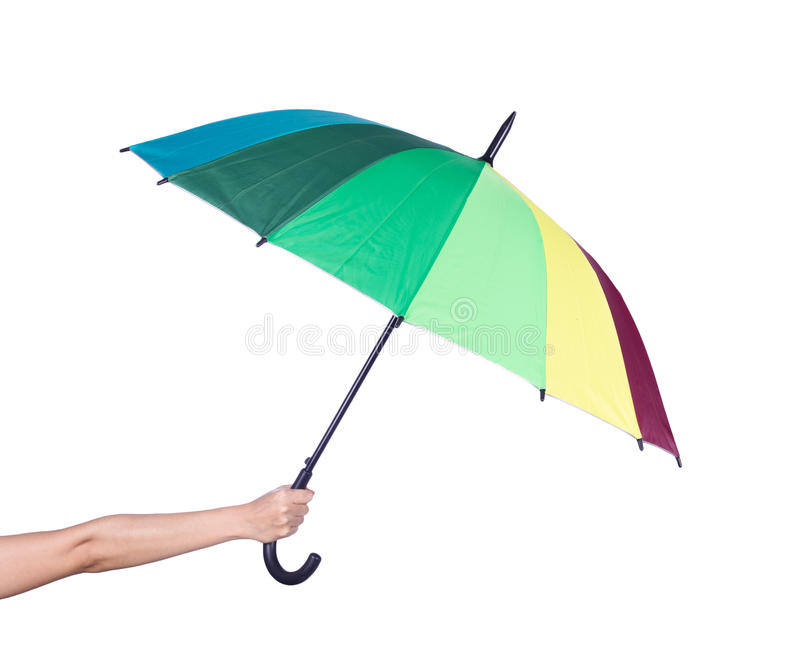 Hand holding multicolored umbrella isolated on white stock photo