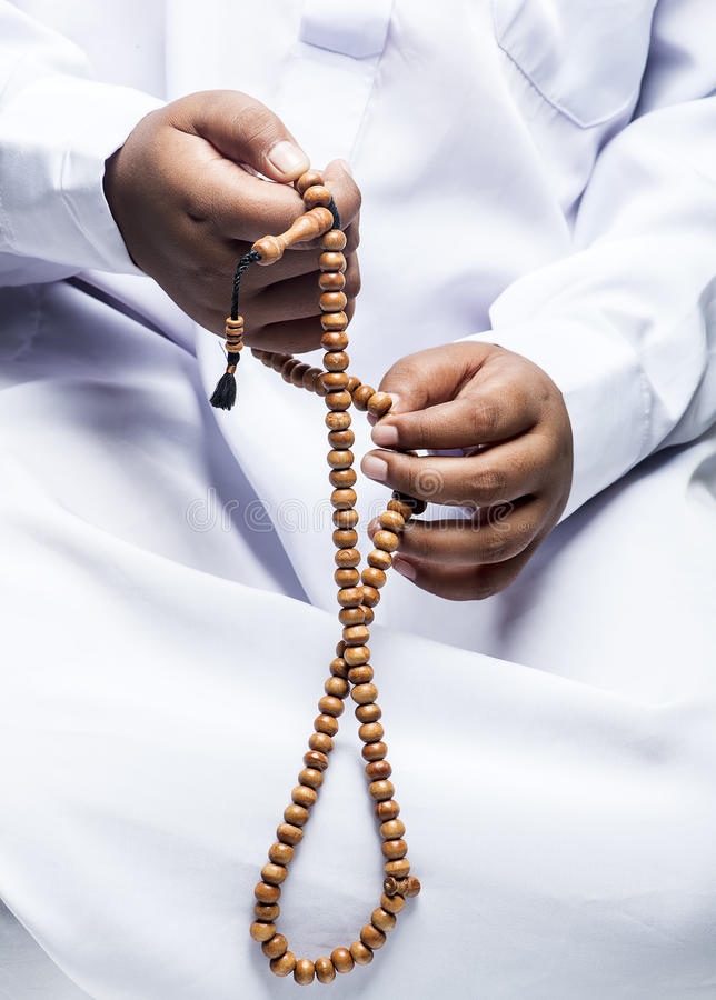 Hand holding a muslim rosary royalty free stock photo