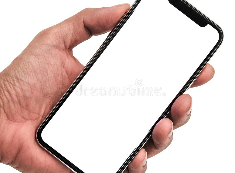 Hand holding, New version of black slim smartphone similar to iphone x stock image