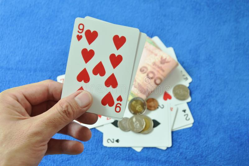 Hand holding nine in baccarat games royalty free stock images
