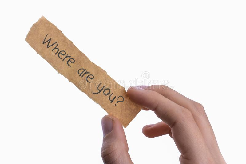 Hand holding a notebook with Where are you text on it stock image