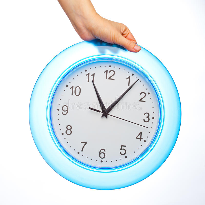Hand Holding Office Clock Royalty Free Stock Image