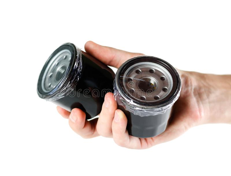 The hand holding the oil filter. Close up. Isolated on white background. royalty free stock photos
